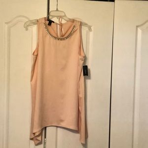 Women's light pink sleeveless tunic.